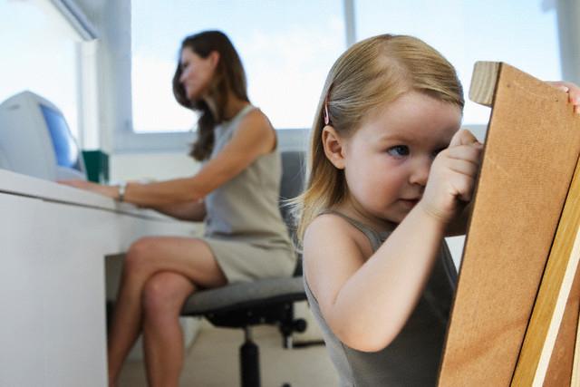 Businesswoman With Daughter Using Blackboard